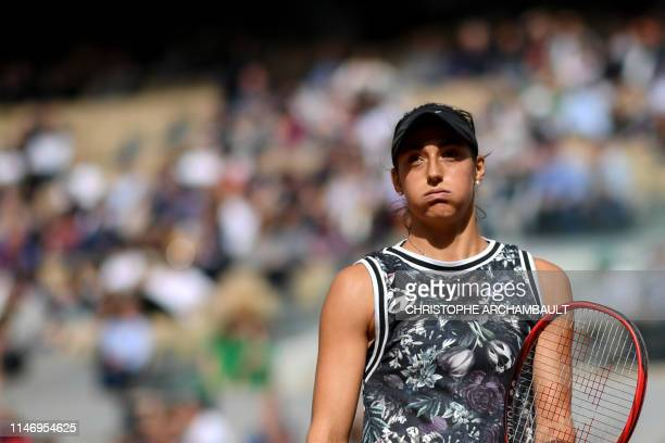 France's Caroline Garcia reacts during her women's singles second round match against Russia's Anna Blinkova on day five of The Roland Garros 2019...