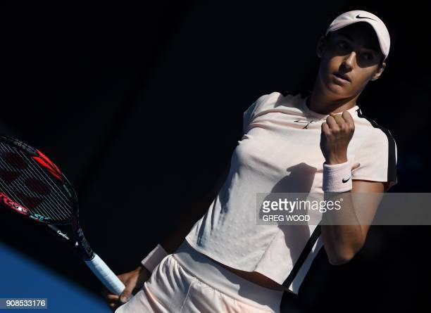 France's Caroline Garcia reacts during their women's singles fourth round matchagainst Madison Keys of the US on day eight of the Australian Open...