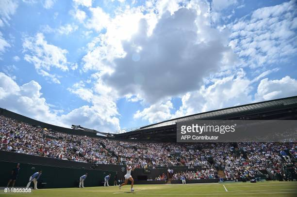 TOPSHOT France's Caroline Garcia returns against Britain's Johanna Konta during their women's singles fourth round match on the seventh day of the...