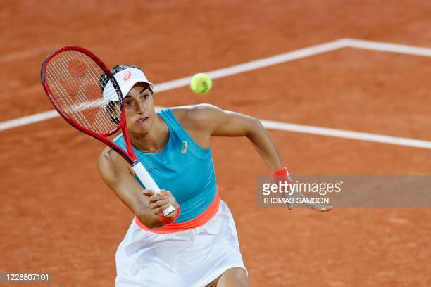 France's Caroline Garcia returns the ball to Belarus' Aliaksandra Sasnovich during their women's singles second round tennis match on Day 4 of The...
