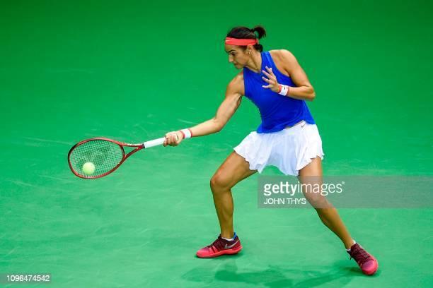 France's Caroline Garcia returns the ball to Belgium's Alison Van Uytvanck during the FedCup World group first round tennis match between Belgium and...
