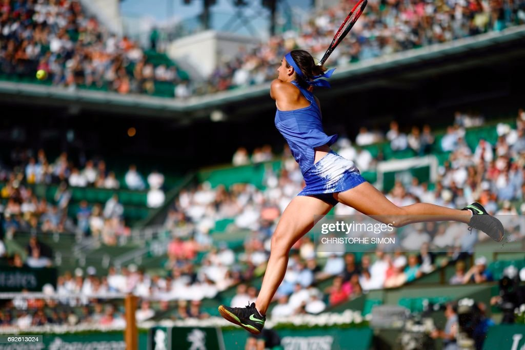 TOPSHOT - France's Caroline Garcia returns the ball to France's Alize Cornet during their tennis match at the Roland Garros 2017 French Open on June 5, 2017 in Paris. /