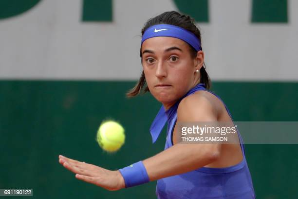 France's Caroline Garcia returns the ball to France's Chloe Paquet during their tennis match at the Roland Garros 2017 French Open on June 1 2017 in...