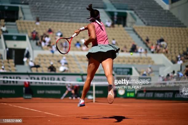 France's Caroline Garcia returns the ball to Germany's Laura Siegemund during their women's singles first round tennis match on Day 2 of The Roland...