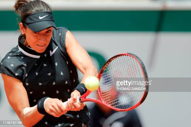 France's Caroline Garcia returns the ball to Germany's Mona Barthel during their women's singles first round match on day three of The Roland Garros...