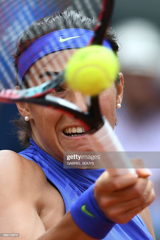 France's Caroline Garcia returns the ball to Japan's Nao Hibino during their tennis match at the Roland Garros 2017 French Open on May 30, 2017 in Paris. /