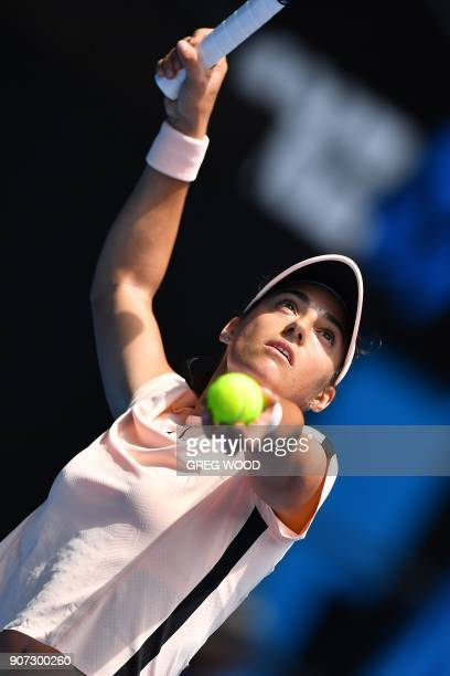 France's Caroline Garcia serves against Belarus' Aliaksandra Sasnovich during their women's singles third round match on day six of the Australian...