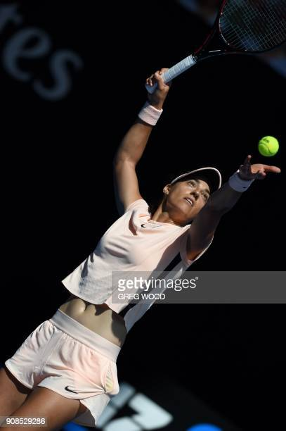 France's Caroline Garcia serves against Madison Keys of the US during their women's singles fourth round match on day eight of the Australian Open...