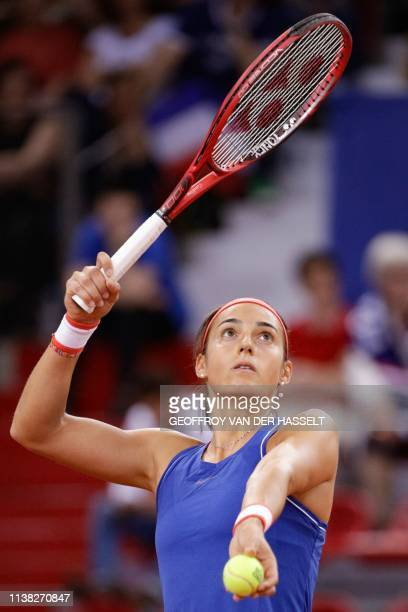 France's Caroline Garcia serves against Romania's Mihaela Buzarnescu in the second rubber of the Fed Cup tennis semifinal match between France and...