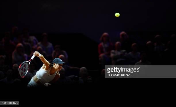 France's Caroline Garcia serves the ball to Ukraine's Elina Svitolina during their quarter-final match at the WTA Porsche Tennis Grand Prix in...