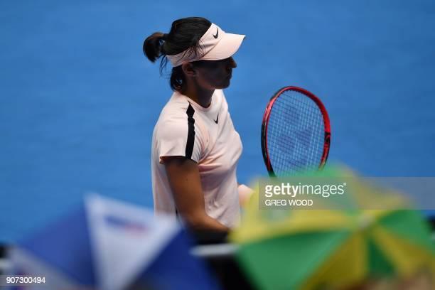 France's Caroline Garcia walks during their women's singles third round match against Belarus' Aliaksandra Sasnovich on day six of the Australian...