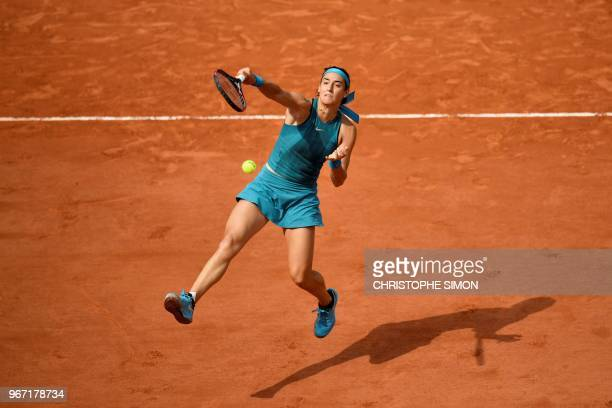 France's Caroline Garciaplays a forehand return to Germany's Angelique Kerber during their women's singles fourth round match on day nine of The...
