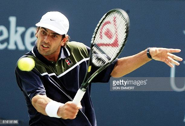 France's Cedric Pioline returns a backhand to Germany's Lars Burgsmuller 03 September 1999 at the US Open in Flushing Meadows New York AFP PHOTO/Don...