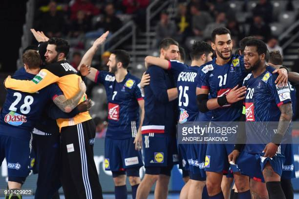 France's Cedric Sorhaindo France's Adrien Dipanda France's goalkeeper Cyril Dumoulin and teammates celebrate winning the match for third place of the...