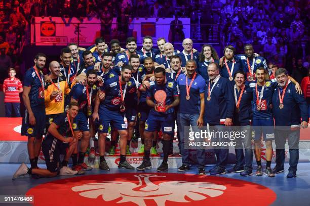 France's Cedric Sorhaindo France's headcoach Didier Dinart France's Nikola Karabatic and teammates pose with theeir bronze medal during the podium...
