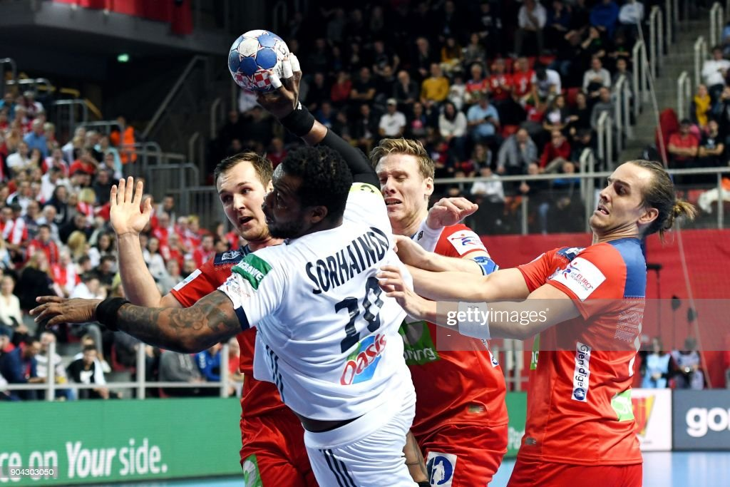 France's Cedric Sorhaindo (2ndL) vies with Norway's Christian O'Sullivan (L), Magnus Gullerud (2ndR) and Kent Robin Tonnesen during the preliminary round group B match of the Men's 2018 EHF European Handball Championship between France and Norway in Porec, Croatia on January 12, 2018. /