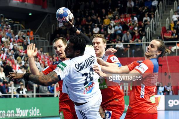 France's Cedric Sorhaindo vies with Norway's Christian O'Sullivan Magnus Gullerud and Kent Robin Tonnesen during the preliminary round group B match...