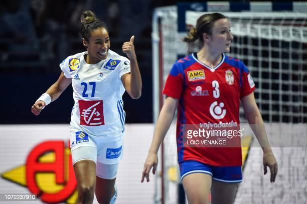 France's center back Estelle Nze Minko celebrates a goal during the Women Euro 2018 handball Championships Group 1 main round match between Serbia...