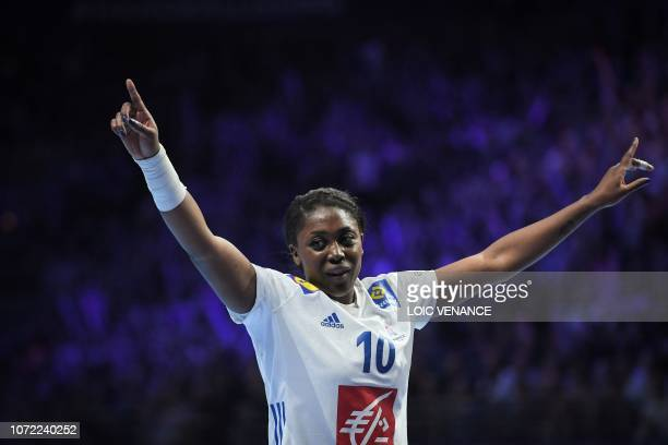 France's center back Grace Zaadi celebrates a goal during the Women Euro 2018 handball Championships Group 1 main round match between Serbia and...