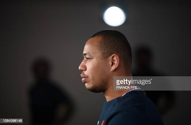 France's center Gael Fickou speaks during a press conference on February 5 2019 in Marcoussis south of Paris as part of the preparation of the Six...