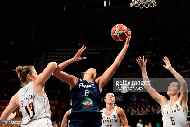 France's center Helena Ciak vies with Belgium' center Kyara Linskens and Belgium's forward Antonia Delaere during the FIBA 2018 Women's Basketball...