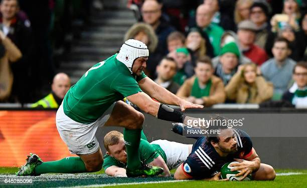 France's center Remi Lamerat runs past Ireland's wing Keith Earls and Ireland's hooker Rory Best to score a try which was consequently disallowed,...