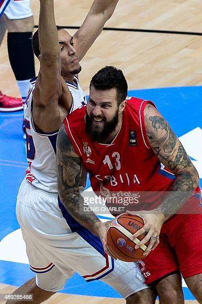 France's center Rudy Gobert defends against Serbia's center Miroslav Raduljica during the third place basketball match between France and Serbia at...