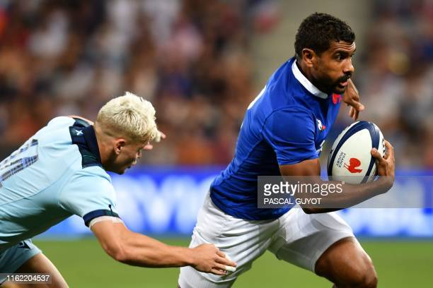 France's center Wesley Fofana runs with the ball as Scotland's winger Darcy Graham attempts to tackle him during the 2019 Rugby World Cup warmup test...