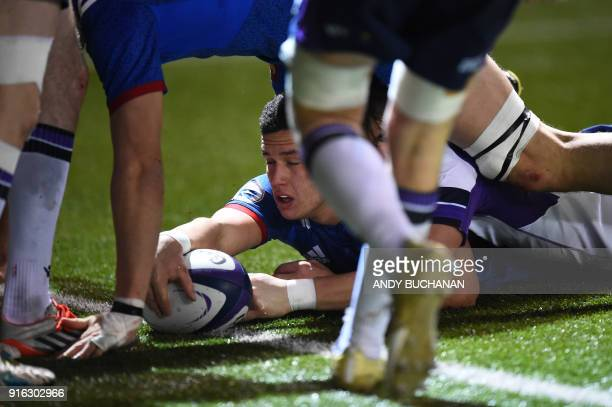 France's centre Adrien Seguret scores a try during the Six Nations U20 rugby union match between Scotland and France at the Broadwood Stadium in...