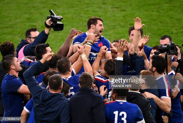 France's centre Arthur Retiere celebrates with teammates after winning the Six Nations rugby union tournament match between France and Ireland at the...
