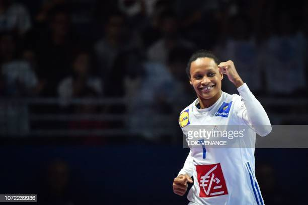 France's centre back Allison Pineau celebrates a goal during the Women Euro 2018 handball Championships Group 1 main round match between Serbia and...
