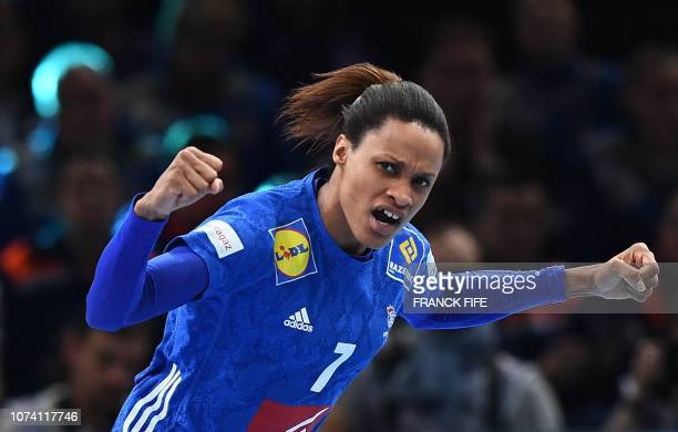 France's centre back Allison Pineau reacts after scoring a goal during the EHF EURO 2018 European Women's Handball Championship Final match between...