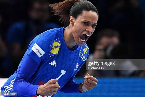 TOPSHOT France's centre back Allison Pineau reacts after scoring a goal during the EHF EURO 2018 European Women's Handball Championship Final match...