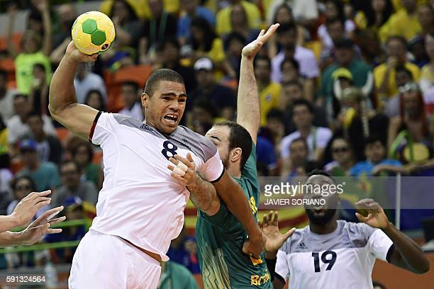 TOPSHOT France's centre back Daniel Narcisse vies with Brazil's centre back Henrique Teixeira during the men's quarterfinal handball match Brazil vs...
