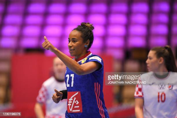 France's Centre back Estelle Nze Minko celebrates after a goal during the semi-final match between France and Croatia of the 2020 EHF European...