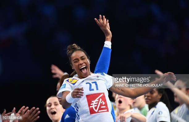 France's centre back Estelle Nze Minko celebrates her team's victory at the end of the EHF EURO 2018 European Women's Handball Championship semifinal...