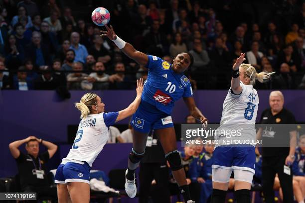 France's centre back Grace Zaadi vies with Russia's left wing Polina Kuznetsova and Russia's left back Anna Sen during the EHF EURO 2018 European...