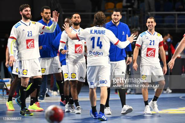 France's centre back Kentin Mahe celebrates with teammates their victory at the end of the 2021 World Men's Handball Championship between Group E...