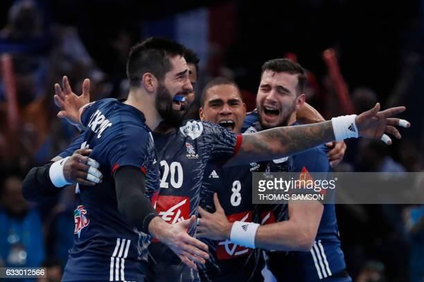 TOPSHOT France's centre back Nikola Karabatic France's centre back Daniel Narcisse and France's right back Nedim Remili celebrate after winning the...