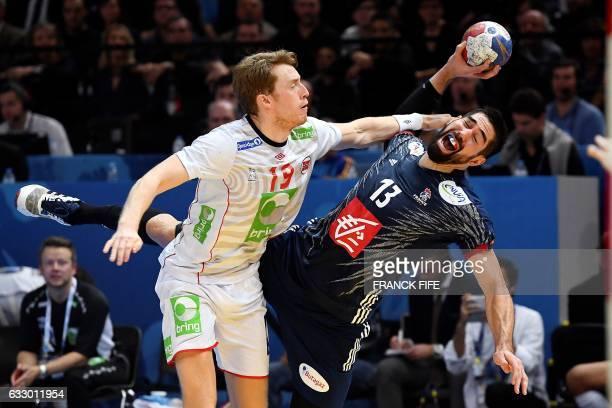 France's centre back Nikola Karabatic jumps to shoot on goal despite Norway's right wing Kristian Bjornsen during the 25th IHF Men's World...