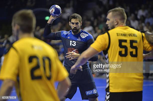 France's centre back Nikola Karabatic passes the ball during the 2018 EHF Men's European Handball Championship qualification match between France and...