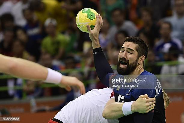TOPSHOT France's centre back Nikola Karabatic vies with a Danish player during the men's Gold Medal handball match Denmark vs France for the Rio 2016...