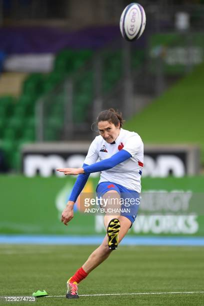 France's centre Elise Pignot kicks a penalty during the Women's Six Nations rugby union match between Scotland and France at Scotstoun Stadium in...