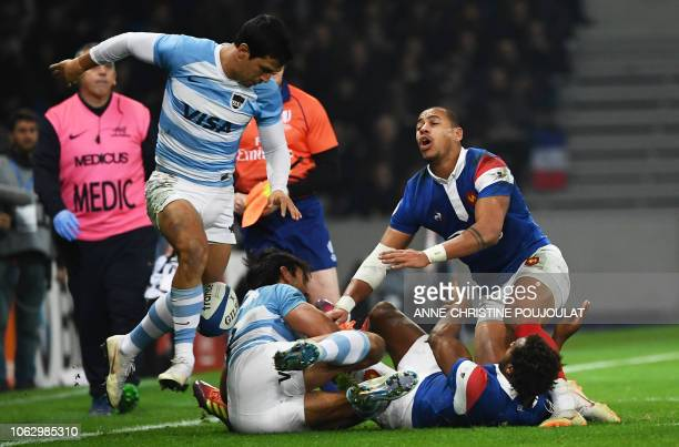 France's centre Gael Fickou and France's back row Benjamin Fall vie for the ball with Argentia's centre Matias Moroni during the international rugby...