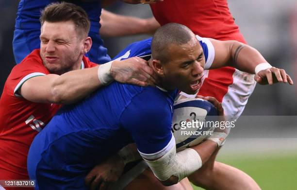 France's centre Gael Fickou is tackled by Wales' fly-half Dan Biggar during the Six Nations rugby union tournament match between France and Wales on...