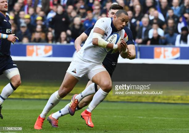 France's centre Gael Fickou runs for a try which is then refused during the Six Nations rugby union tournament match between France and Scotland at...