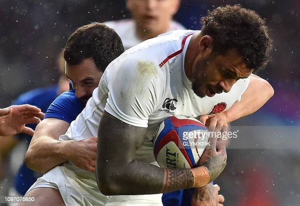 TOPSHOT France's centre Geoffrey Doumayrou tackles England's lock Courtney Lawes during the Six Nations international rugby union match between...