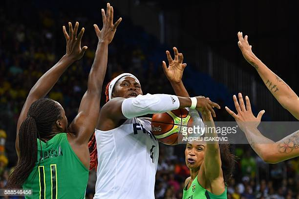 France's centre Isabelle Yacoubou is cornered by Brazil's power forward Clarissa Santos and Brazil's shooting guard Iziane Castro during a Women's...