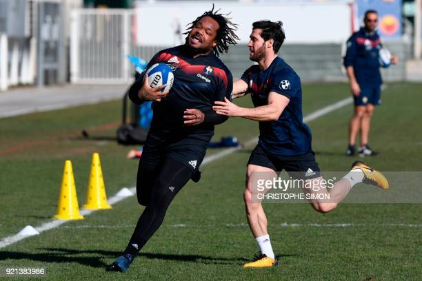 France's centre Mathieu Bastareaud and France's scrum-half Maxime Machenaud practice during a training session of the French national rugby team at...