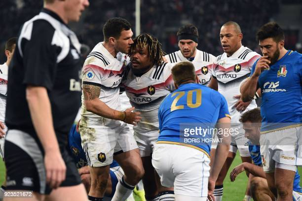 France's centre Mathieu Bastareaud celebrates with teammates after scoring a try during the Six Nations international rugby union match between...